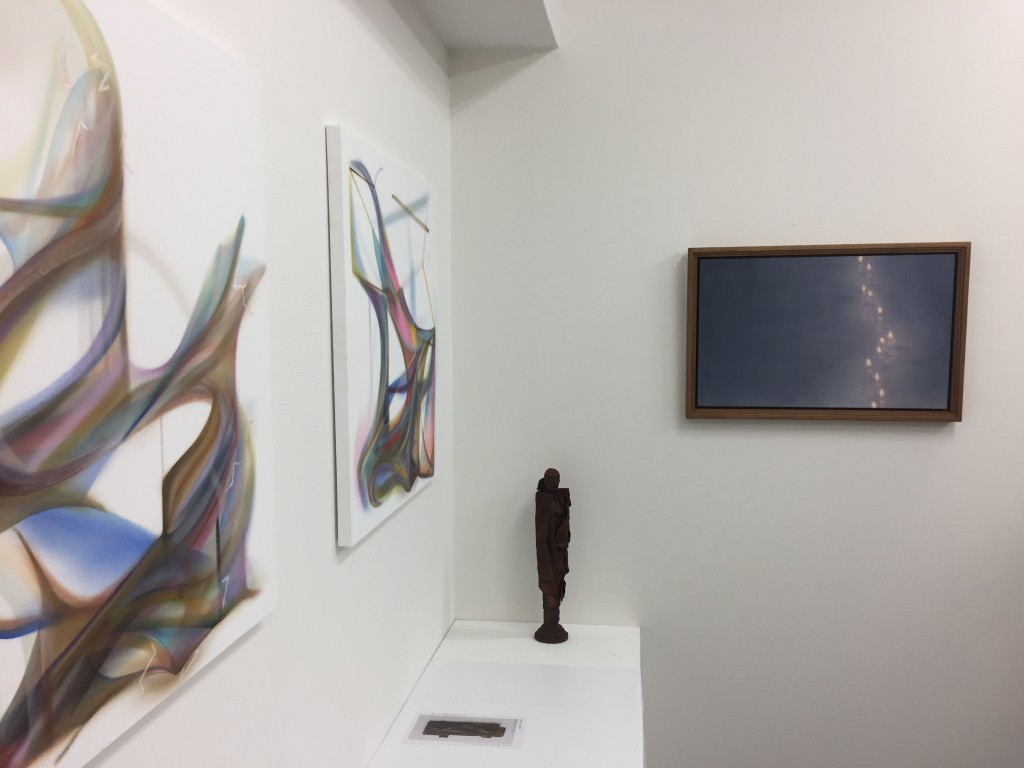 Paintings by Naomi Yuki, sculpture by Tadashi Aono, painting by Kojiro. (from left to right)